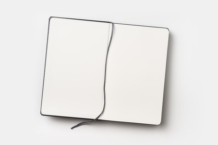 Business concept - Top view of black fly black notebook front with bookmark on background for mockup