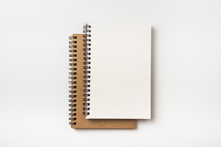 Business concept - Top view collection of two kraft spiral notebook isolated on background for mockup