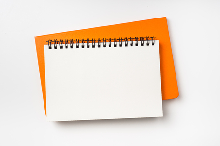 Business concept - Top view collection of two notebook ( kraft spiral and orange hardcover ) isolated on background for mockup Фото со стока