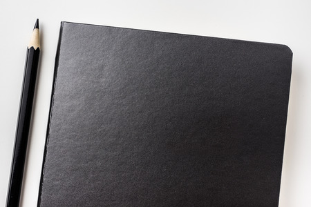 Business concept - Top view collection of black hardcover notebook and black pencil isolated on background for mockup Stock Photo