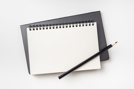 Business concept - Top view collection of two notebook ( kraft spiral and hardcover ) and black pencil isolated on background for mockup