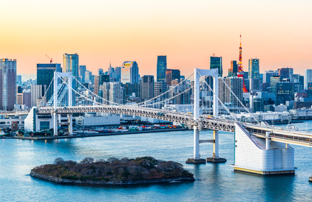 Asia Business concept for real estate and corporate construction - panoramic modern city skyline bird eye aerial view of Odaiba, tokyo tower & rainbow bridge under neon night in Tokyo, Japan