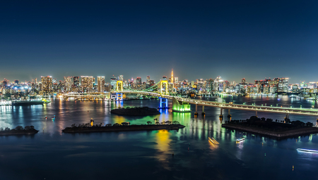 Asia Business concept for real estate & corporate construction - panoramic modern city skyline view  of tokyo tower & rainbow bridge with neon night in Odaiba, Tokyo, Japan