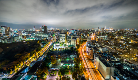 Asia business concept for real estate and corporate construction - panoramic modern city skyline aerial night view of bunkyo, tokyo, Japan
