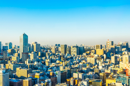 Asia business concept for real estate and corporate construction - panoramic urban city skyline aerial view under twilight sky and golden sun in hamamatsucho, tokyo, Japan Stock Photo