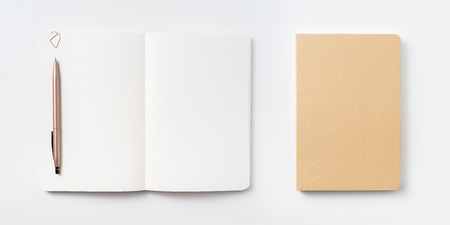 Design concept - Top view of notebook blank page and ballpoint pen isolated on white background for mockup
