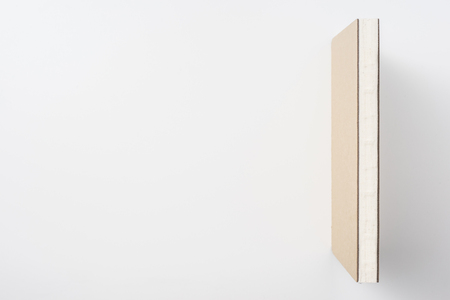 Design concept - Top view of hardcover kraft notebook like bookshelf isolated on white background for mockup
