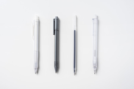 Top view of collection of mechanical pencil  on white background desk for mockup