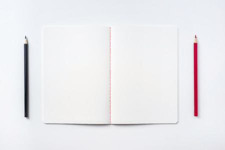 Design concept - Top view of notebook blank page and pencil isolated on white background for mockup