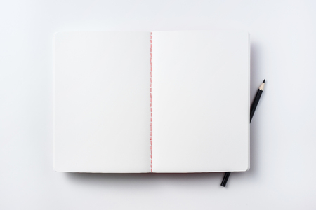 Design concept - Top view of notebook blank page and black pencil isolated on white background for mockup Stock Photo
