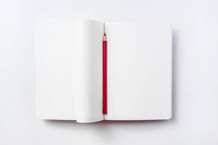 Design concept - Top view of curl notebook blank page and red pencil isolated on white background for mockup Stock Photo
