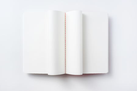 Design concept - Top view of curl notebook blank page isolated on white background for mockup Stock Photo