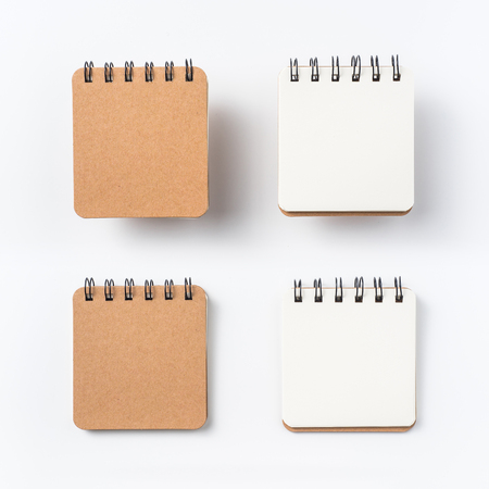 Design concept - Top view of spiral kraft notebook isolated on white background for mockup