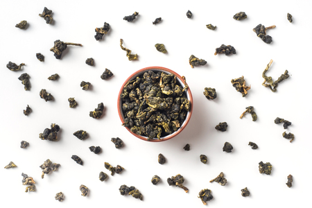 Asia culture and design concept - fresh taiwan oolong tea dry leaves in cup
