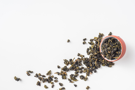 Asia culture and design concept - fresh taiwan oolong tea dry bud in chinese porcelain teacup Stock Photo