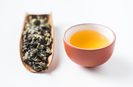 Asia culture and design concept - fresh taiwan oolong tea dry bud and chinese porcelain teacup