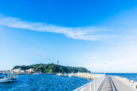Asia travel concept - the famous travel place, enoshima island under dramatic blue sky in kamakura, Japan.