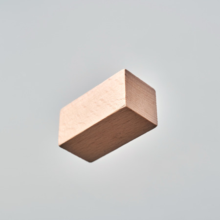 Business  and  design concept - Abstract geometric real floating wooden cuboid isolated on background, its not 3D render.