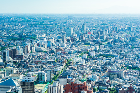Asia Business concept for real estate and corporate construction - panoramic modern city skyline aerial view of shinjuku area under bright blue sky and sun in Tokyo, Japan Foto de archivo - 112880498