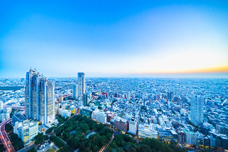 Asia Business concept for real estate and corporate construction - panoramic modern city skyline aerial view of shinjuku area under twilight sky and dramatic sunset in Tokyo, Japan Foto de archivo - 112880503