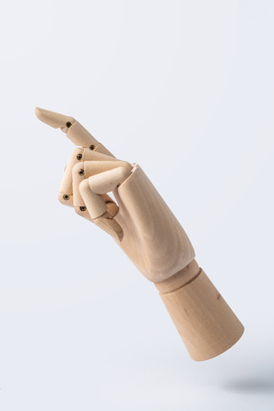 Business and design concept - wooden hand with number 1 posture isolated on white background 免版税图像 - 112880805