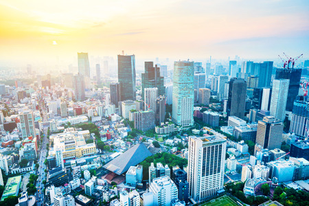 Asia Business concept for real estate and corporate construction - panoramic modern city skyline aerial view under bright blue sky and sun in Tokyo, Japan