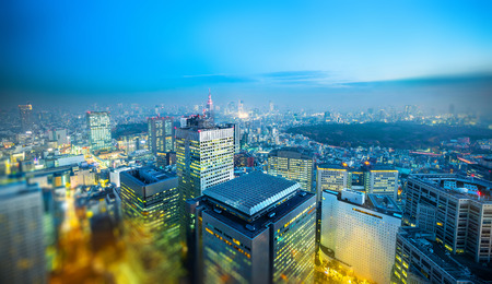 Asia business concept for real estate and corporate construction - panoramic city skyline aerial view under blue sky  and sun in Shinjuku Tokyo, Japan with tilt shift, miniature, blur effect