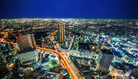 Asia Business concept for real estate  and corporate construction - panoramic modern city skyline night view with expressway in Ikebukuro district, Tokyo, Japan