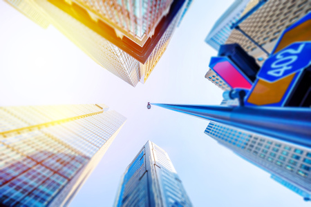 Asia Business concept for real estate and corporate construction - looking up view of modern city skyline with blue sky in tokyo, japan with tilt shift, miniature, blur effect