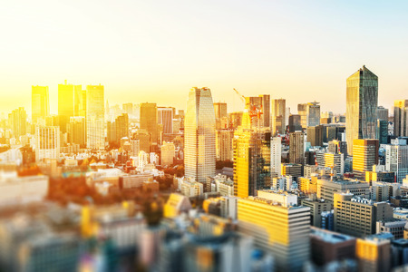 Asia business concept for real estate and corporate construction - panoramic city skyline aerial view under blue sky  and sun in Tokyo, Japan with tilt shift, miniature, blur effect Foto de archivo