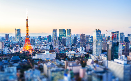 Asia Business concept for real estate and corporate construction - panoramic city view and tokyo tower under neon night in tokyo, Japan with tilt shift, miniature, blur effect Stockfoto