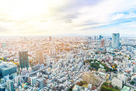 Asia Business concept for real estate and corporate construction - panoramic urban city skyline aerial view under bright blue sky and sun in Tokyo, Japan 免版税图像 - 113998130