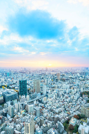 Asia Business concept for real estate and corporate construction - urban city skyline aerial night view under blue sky and neon light in Tokyo, Japan Stock Photo