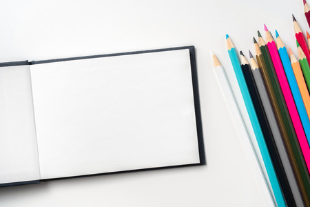 Design concept - Top view of blue hardcover notebook and a lot of pencil isolated on background for mockup