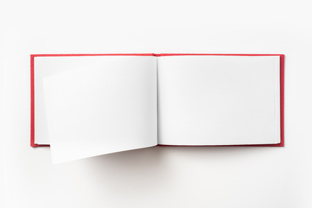 Design concept - Top view red hardcover notebook with open and flip curl rolled page isolated on background for mockup Stock Photo