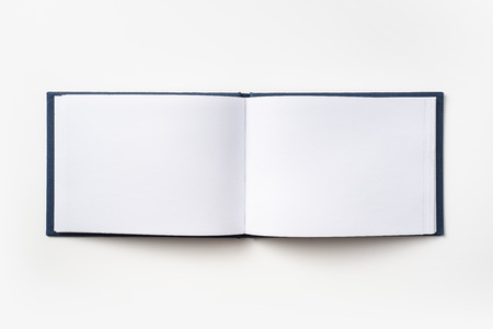 Design concept - Top view blue hardcover notebook with open  and flip curl rolled page isolated on background for mockup