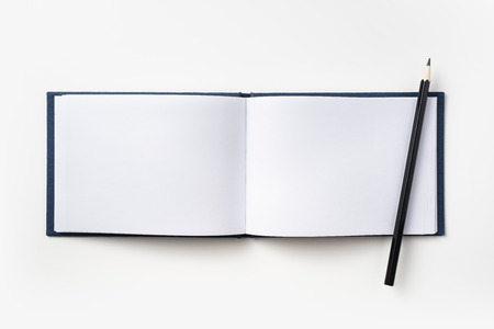 Design concept - Top view of blue hardcover notebook and pencil isolated on background for mockup
