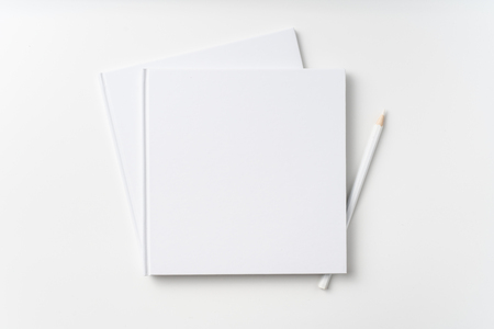 Design concept - Top view of 2 pure white notebook, white page and pencil isolated on background for mockup