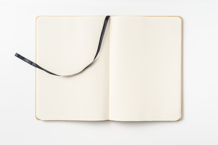 Design concept - Top view of  paper notebook, white page and bookmark isolated on background 免版税图像