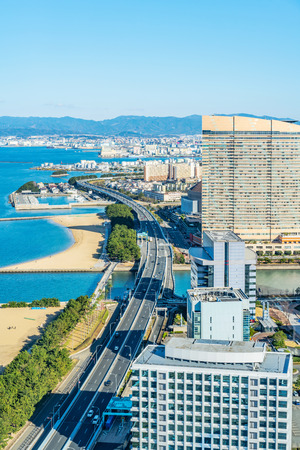 Asia Business concept for real estate and corporate construction - panoramic urban townscape aerial view of beach park under bright blue sky and sun in Fukuoka Japan Stock Photo