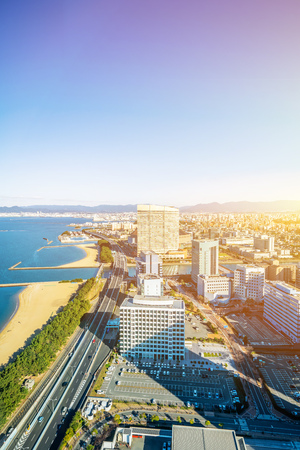 Asia Business concept for real estate and corporate construction - panoramic urban townscape aerial view of beach park under bright blue sky and sun in Fukuoka Japan 스톡 콘텐츠