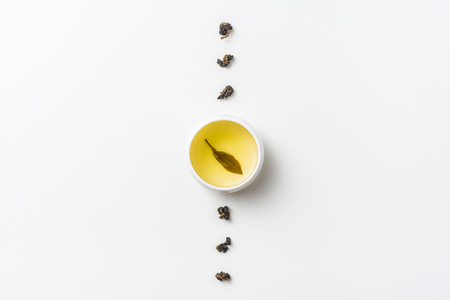 Asia culture and design concept - fresh taiwan oolong tea and cup Reklamní fotografie - 115593095