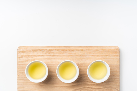Asia culture and design concept - fresh taiwan oolong tea and cup with wood board Stock Photo