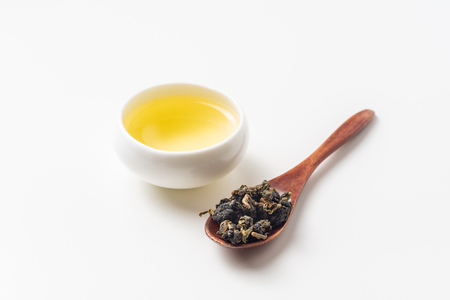 Asia culture and design concept - fresh taiwan oolong tea and cup