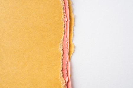 Design concept - teared yellow and red folded japanese washi paper for mockup Archivio Fotografico