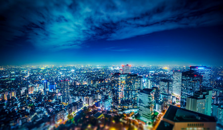 Asia Business concept for real estate and corporate construction - panoramic modern city skyline aerial night view of Shinjuku in Tokyo, Japan. miniature lens tilt shift blur effect