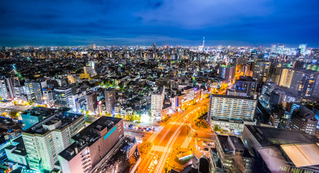 Asia Business concept for real estate  and  corporate construction - panoramic modern city skyline view of Shibuya & expressway with neon night in bunkyo district, Tokyo, Japan