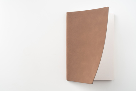 Design concept - Top view of opening high grade red notebook cover isolated on white background for mockup