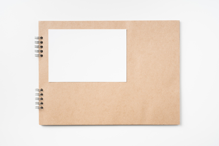 Design concept - Top view of kraft notebook, photo frame and pen isolated on white background for mockup