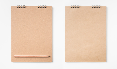 Design concept - Top view of kraft notebook and pen isolated on white background for mockup 版權商用圖片